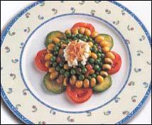 Boliches con guisantes, aguacate, tomate y vinagreta